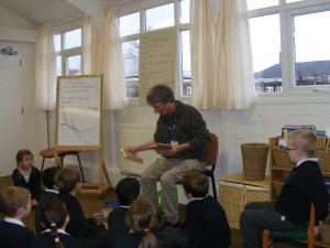 The poet shares some of his work with the children.
