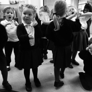 Afternoon Nursery performing actions to the poem about fishing.
