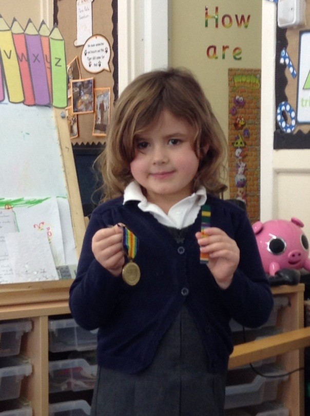 One of the Reception children brought in her Grandad's war medals to show the class.