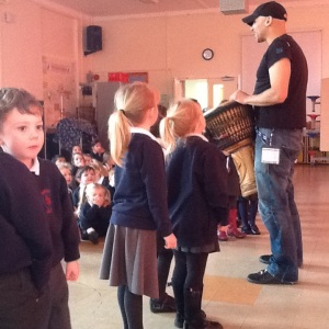 24.2.15.  Foundation stage are about to practise together with Curtis in the hall. It's a big noise!